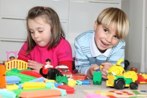 3526850-brother-and-sister-playing-with-toys